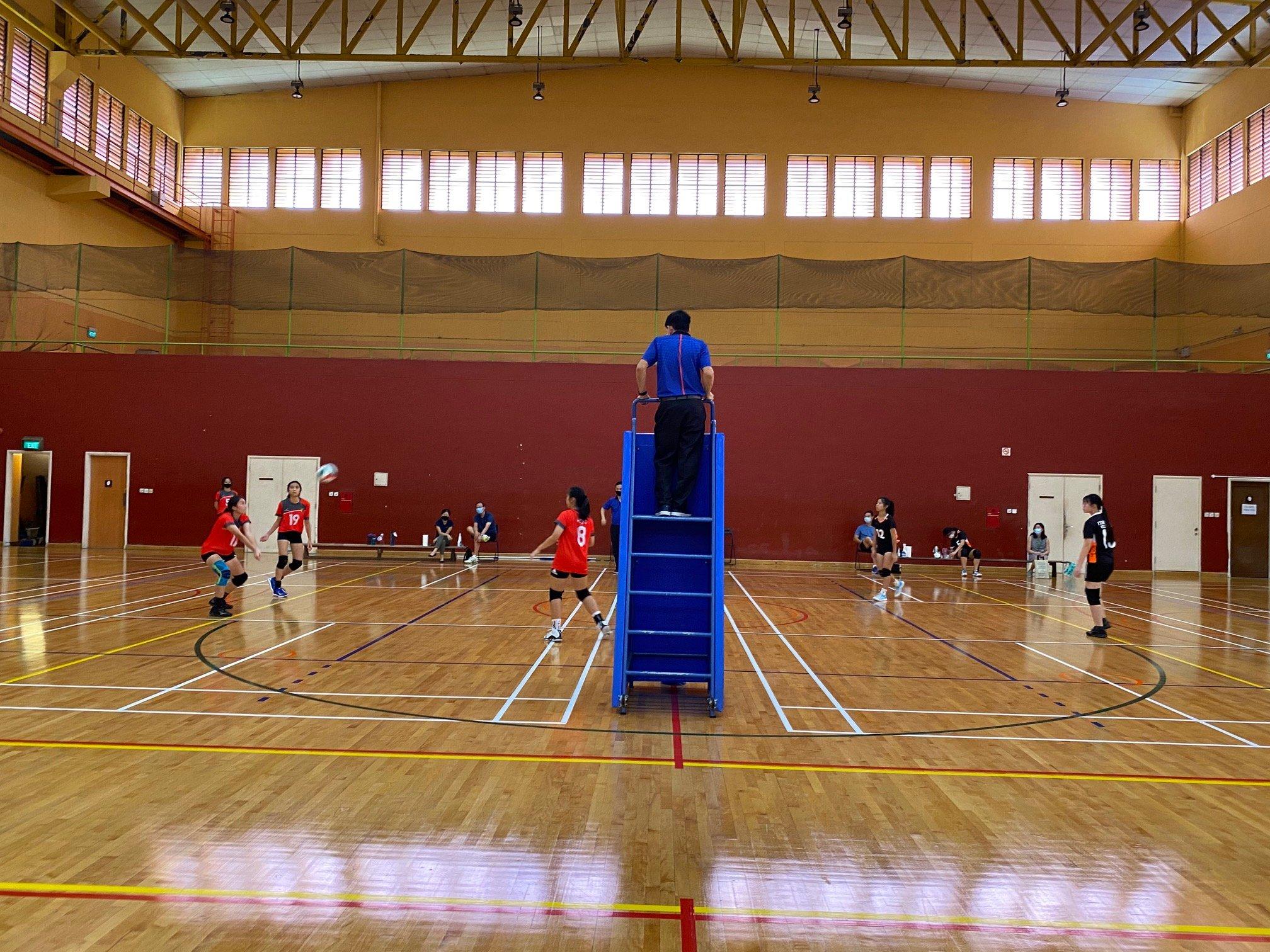 NSG A Div girls' volleyball prelim rd - ACJC (red) vs TJC (black)