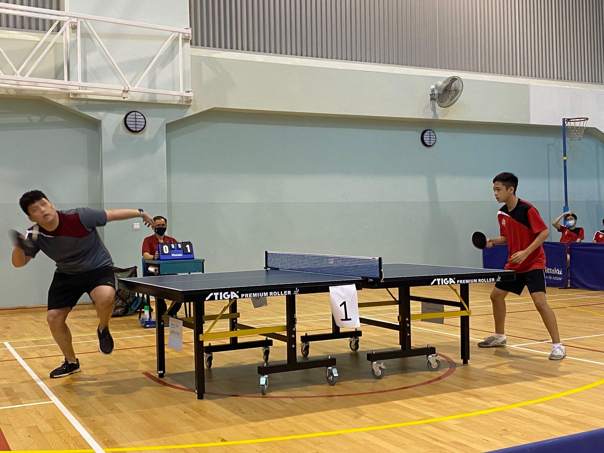 NSG B Div boys table tennis - Pasir Ris Crest (grey) vs Victoria School (red) 1st singles
