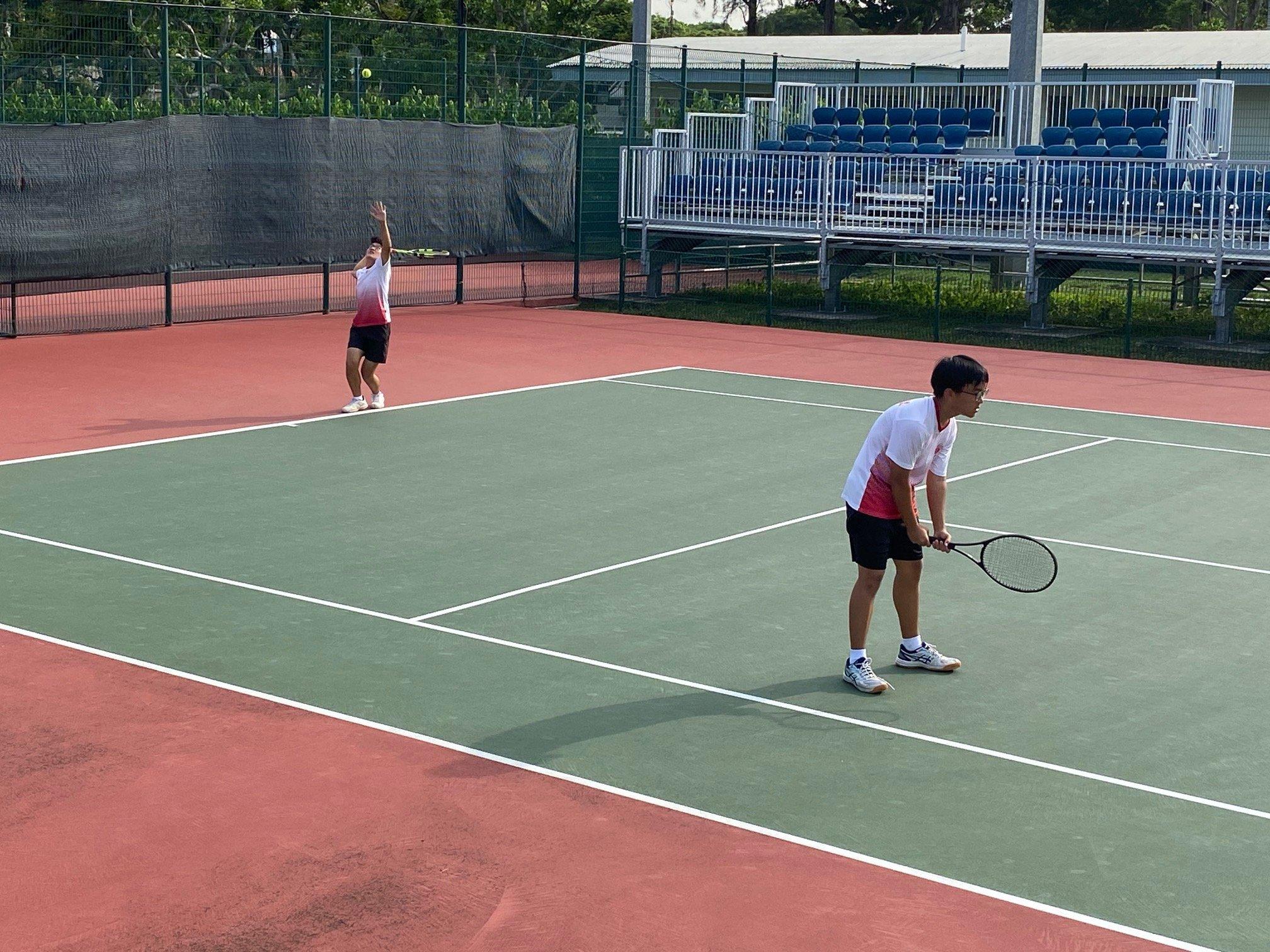 NSG B Div boys tennis - Victoria Schools doubles pair Matthew William Tan and Joshua Chan in action at Kallang Tennis Centre