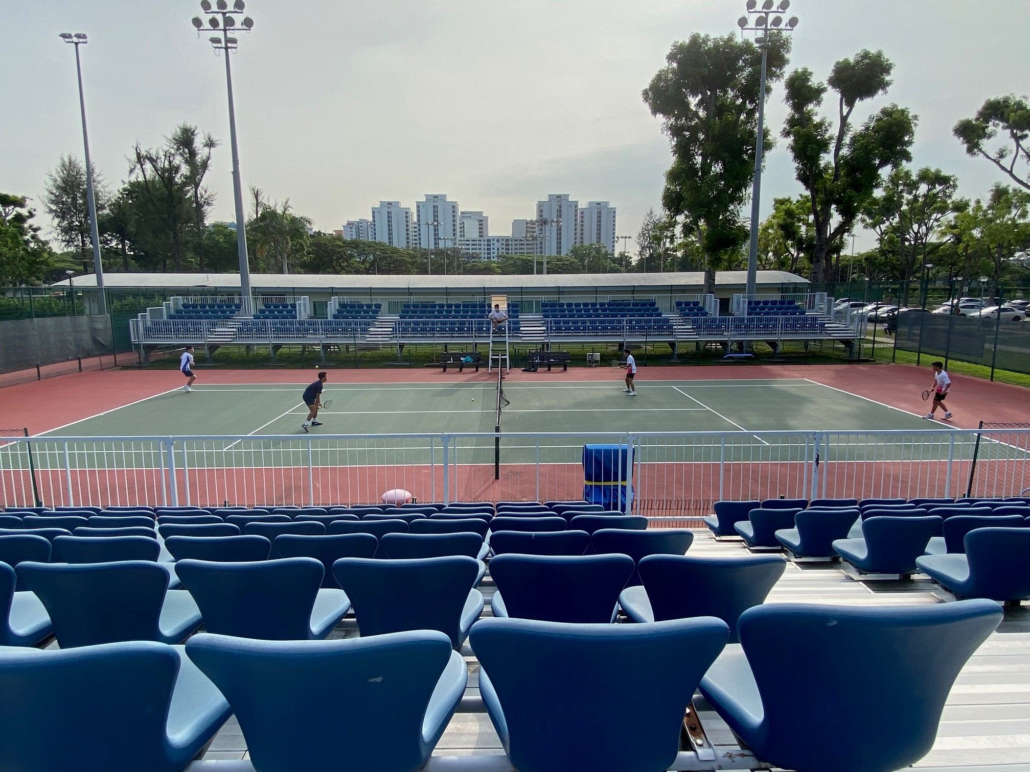 NSG B Div boys tennis -- second doubles match in action at Kallang Tennis Centre