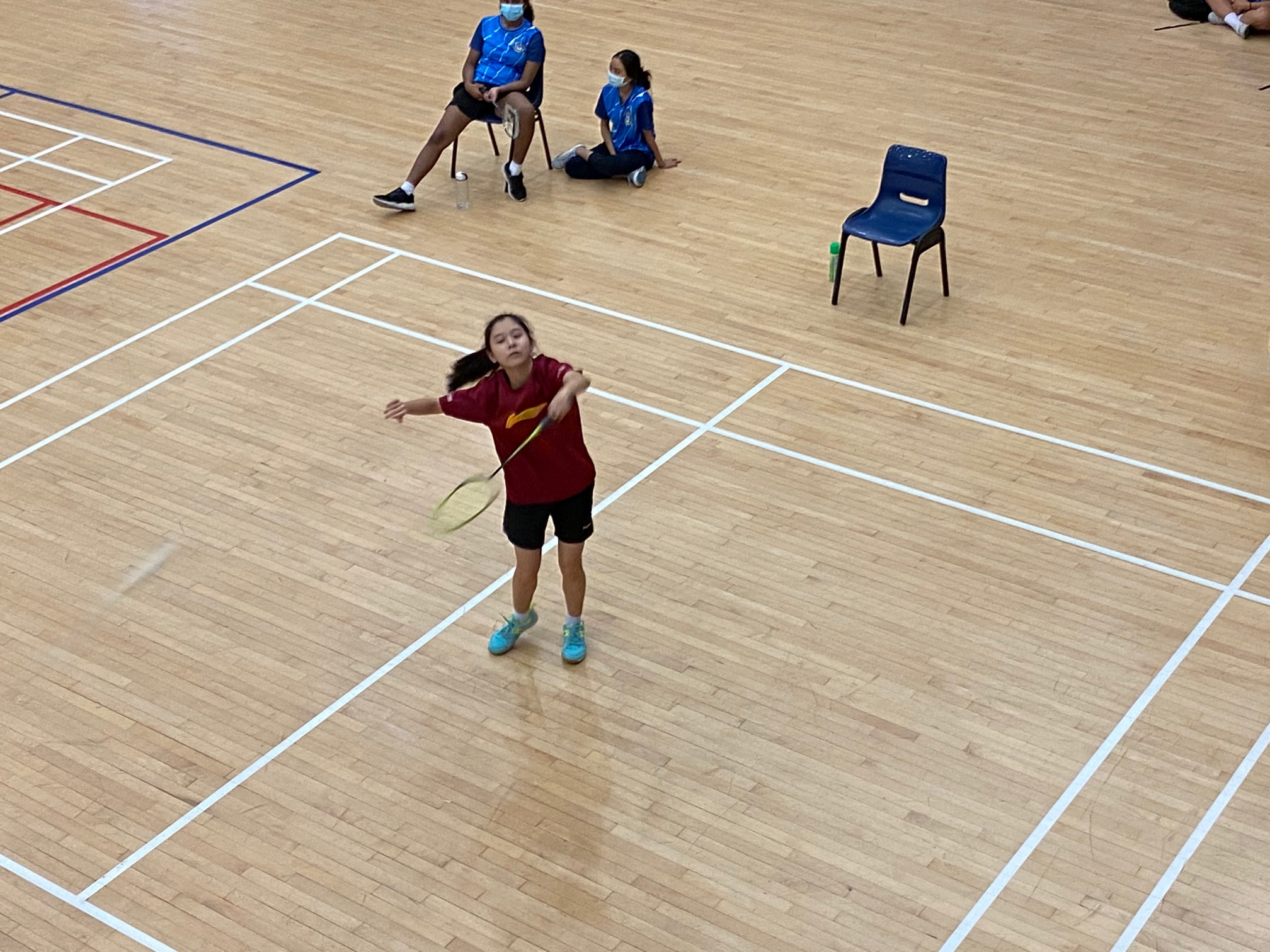 NSG B Div girls badminton - Compassvale (red) first singles