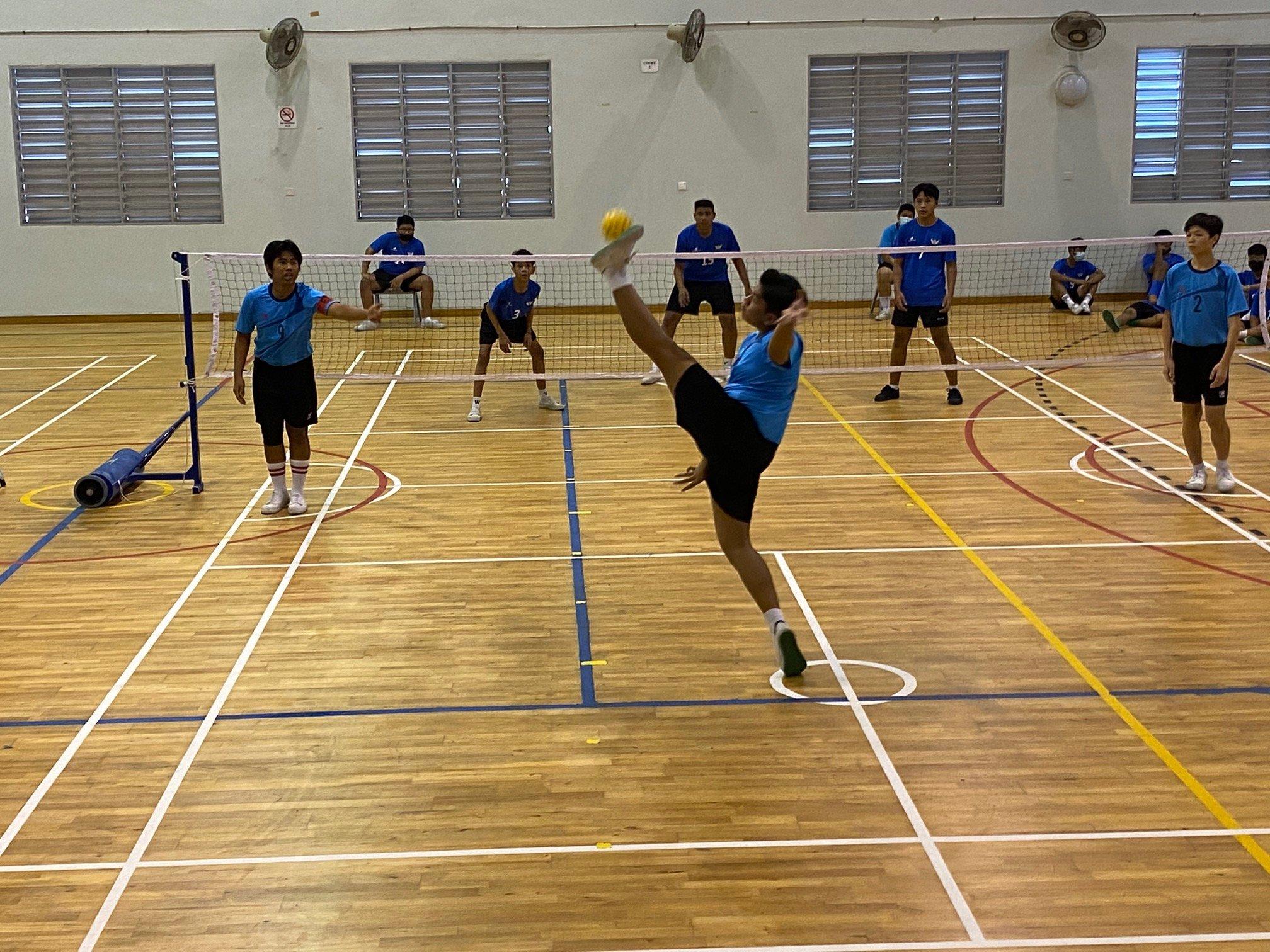 NSG B Div sepak takraw - Bartley Sec (light blue) vs Yishun (dark blue)
