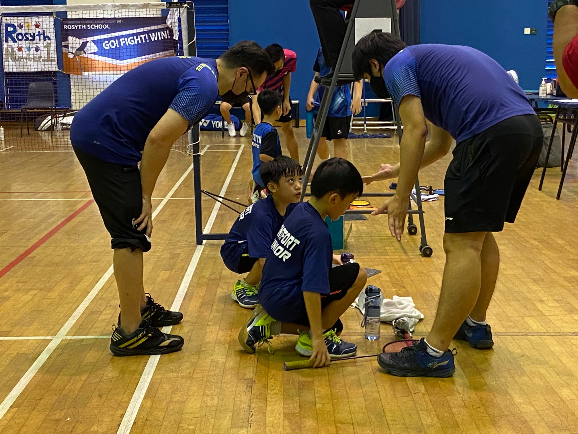 NSG Snr Div North Zone boys' badminton final - Montfort twins and coaches in second doubles