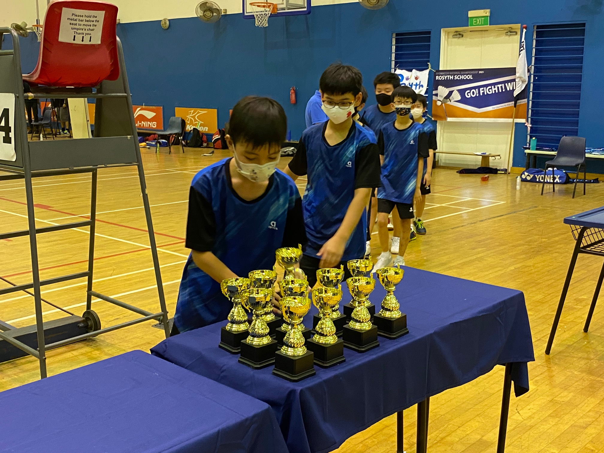 NSG Snr Div North Zone boys' badminton final - Rosyth players getting their trophies