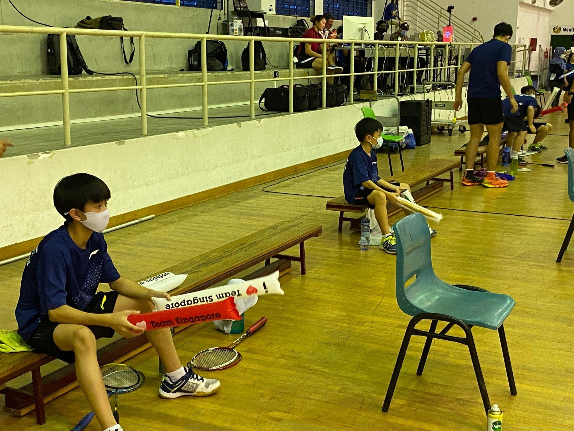 NSG Snr Div North Zone boys' badminton final - teammates with clappers