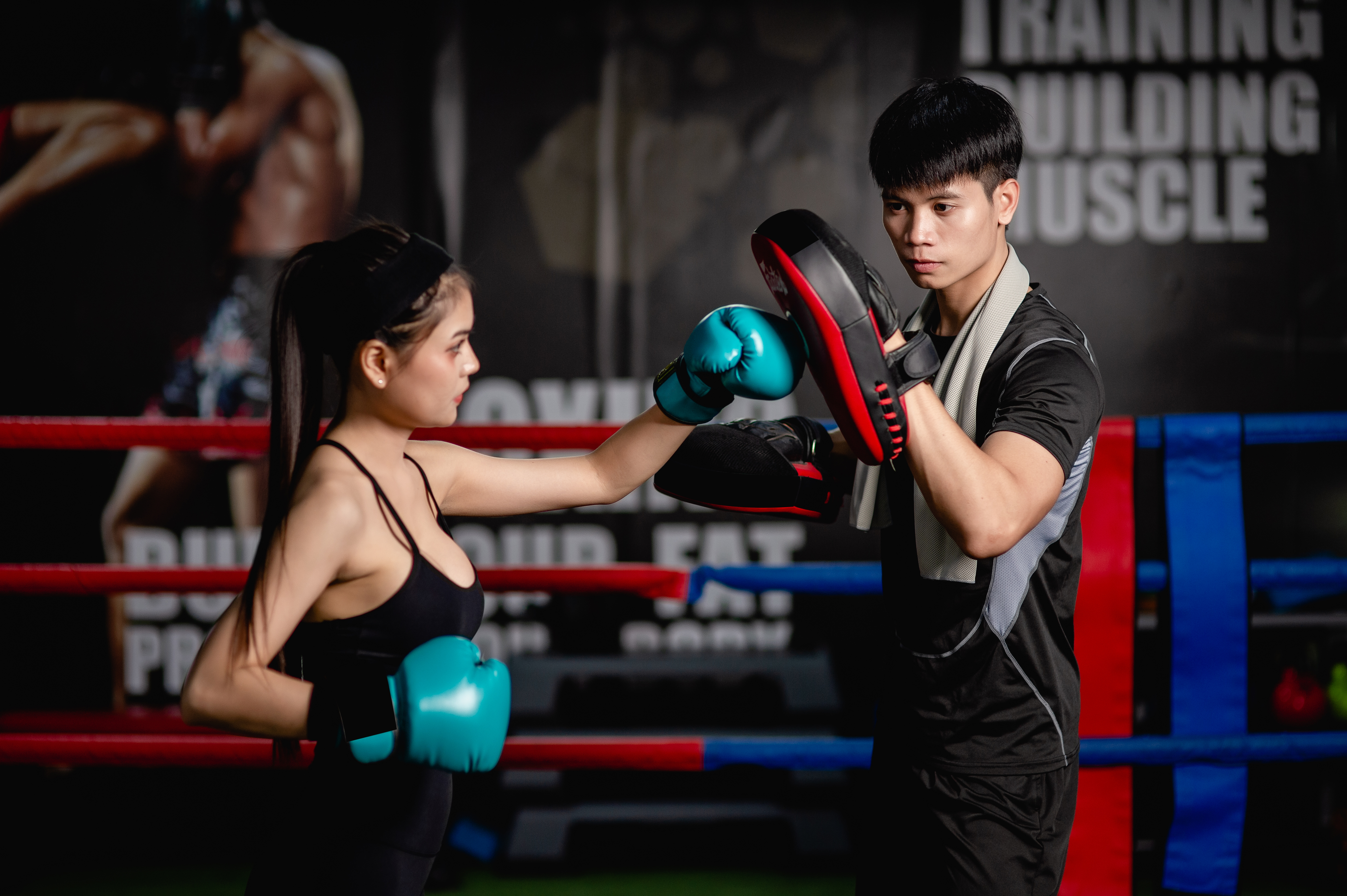 young-fit-woman-doing-exercise-boxing-with-coach-m-2021-06-10-18-43-30-utc